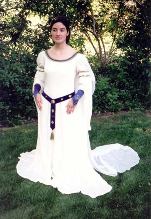 Medieval style flowing white wedding dress with purple accents