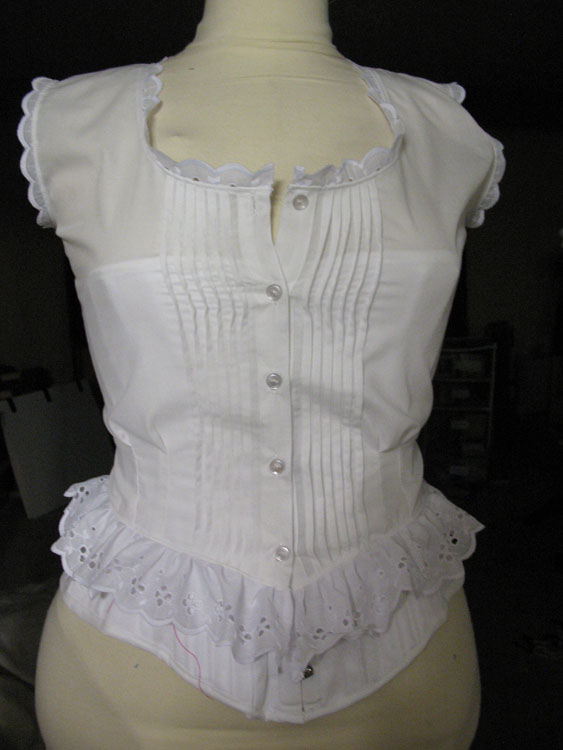 Corset cover worn on top of the corset