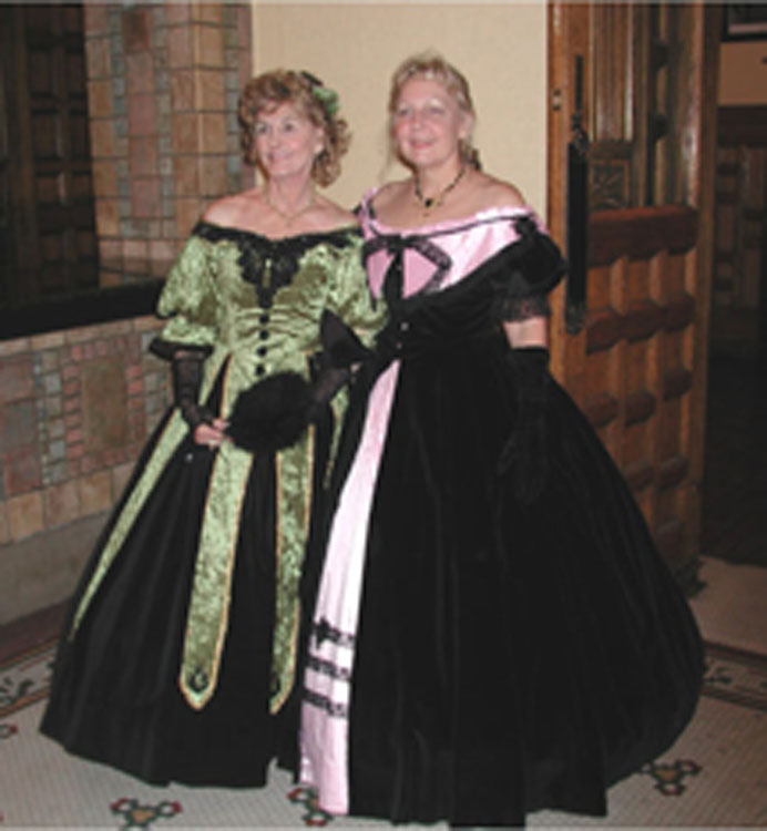 On the right. Black cotton velvet ball gown with pink silk accents