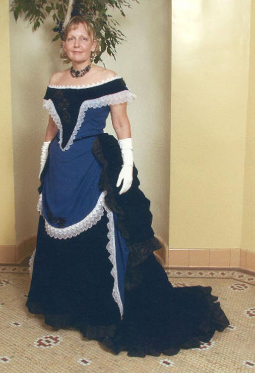 Mid 1880's ball gown with bustle. Black and blue silk velvet